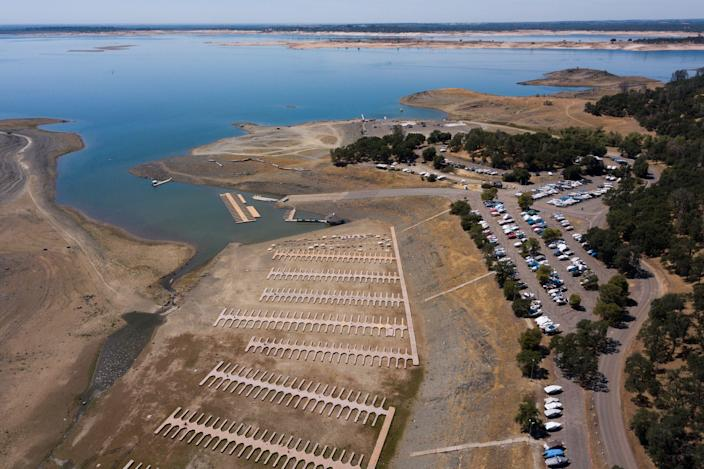 An aerial image shows boats stored in a parking lot after the Folsom Lake Marina closed due to dry lake bed conditions during the California drought emergency on May 27, 2021 in El Dorado Hills, California. A plane wreckage found at the bottom of the lake could solve a decades-old mystery.  (AFP via Getty Images)