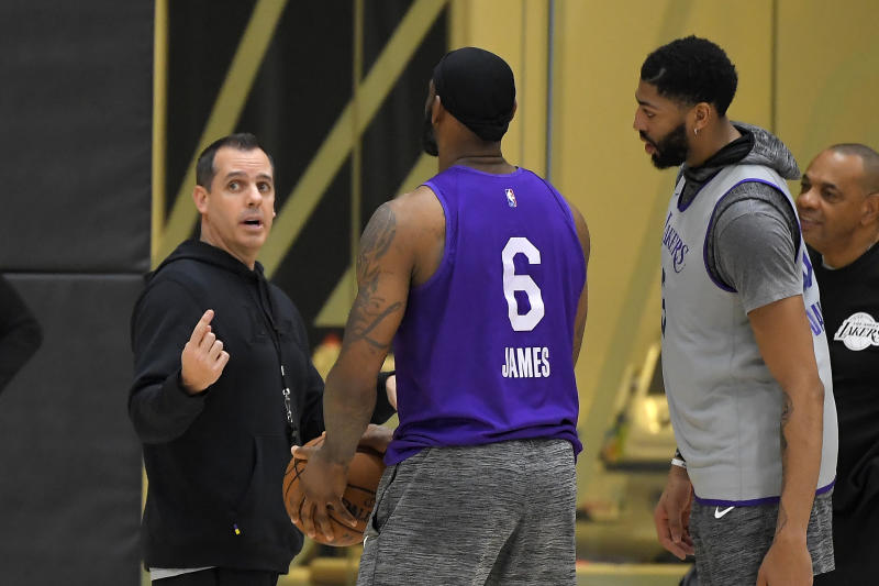 Los Angeles Lakers head coach Frank Vogel, left, talks with forward LeBron James, center, and forward Anthony Davis at their NBA basketball practice facility, Wednesday, Jan. 29, 2020, in El Segundo, Calif. The Lakers held their first practice since the team was rocked by Kobe Bryant's death in a helicopter crash. (AP Photo/Mark J. Terrill)