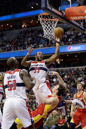 WASHINGTON, DC - FEBRUARY 23: Trevor Booker #35 of the Washington Wizards puts up a shot in front of Omer Asik #3 of the Houston Rockets during the second half at Verizon Center on February 23, 2013 in Washington, DC. (Photo by Rob Carr/Getty Images)
