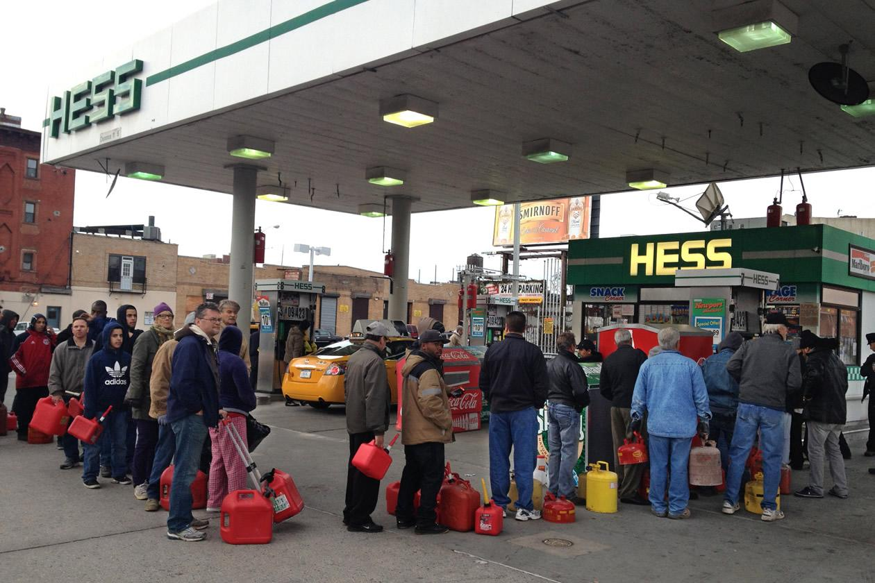 Shortly before the gas ran out, customers wait in line at a Hess station where the line of cars snaked 10 blocks, and at least 60 people waited to fill red gas cans for their generators, in the Gowanus section of  Brooklyn, New York.