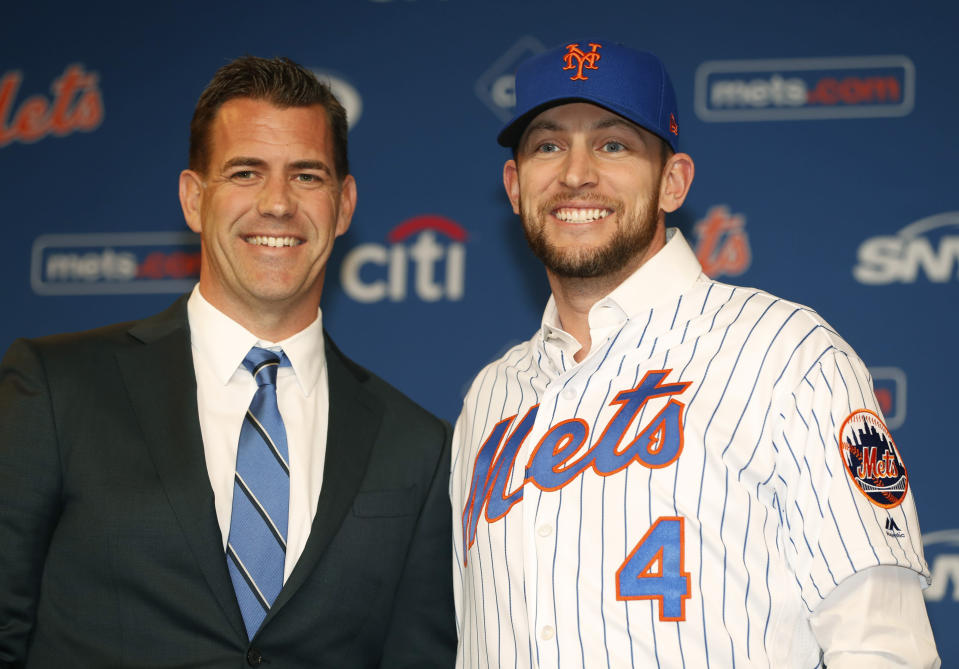 New York Mets General Manager Brodie Van Wagenen (pictured with free-agent signing Jed Lowrie) is laying down the gauntlet to the NL East. (AP)