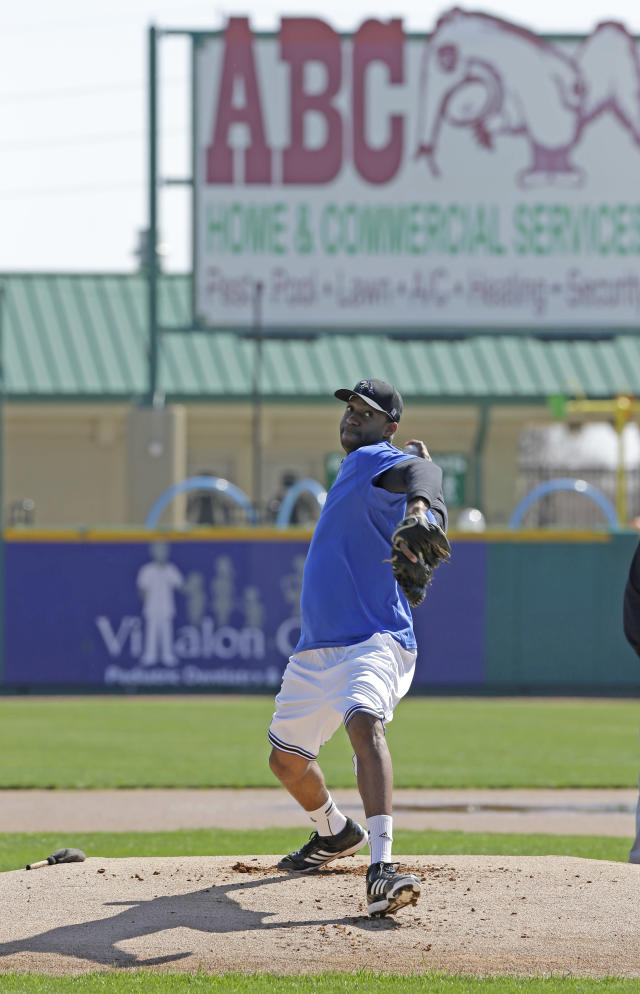 Retired NBA All-Star Tracy McGrady throws a pitch at the Sugar Land Skeeters baseball stadium Wednesday, Feb. 12, 2014, in Sugar Land, Texas. McGrady hopes to try out as a pitcher for the independent Atlantic League Skeeters. (AP Photo/Pat Sullivan)