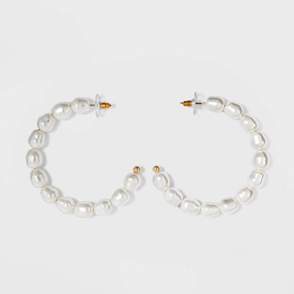 """<p><a href=""""https://www.popsugar.com/buy/SugarFix-BaubleBar-Pearl-Hoop-Earrings-497253?p_name=SugarFix%20by%20BaubleBar%20Pearl%20Hoop%20Earrings&retailer=target.com&pid=497253&price=13&evar1=fab%3Aus&evar9=46708649&evar98=https%3A%2F%2Fwww.popsugar.com%2Ffashion%2Fphoto-gallery%2F46708649%2Fimage%2F46709047%2FSugarFix-by-BaubleBar-Pearl-Hoop-Earrings&list1=shopping%2Cjewelry%2Cunder%20%2450%2Caffordable%20shopping%2Cjewelry%20shopping&prop13=mobile&pdata=1"""" rel=""""nofollow noopener"""" class=""""link rapid-noclick-resp"""" target=""""_blank"""" data-ylk=""""slk:SugarFix by BaubleBar Pearl Hoop Earrings"""">SugarFix by BaubleBar Pearl Hoop Earrings</a> ($13)</p>"""