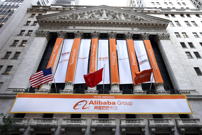 Alibaba banners hang outside the New York Stock Exchange on the day of the company's initial public offering, Friday, Sept. 19, 2014 in New York. The Chinese e-commerce giant goes public Friday in a record busting share sale. (AP Photo/Jason DeCrow)