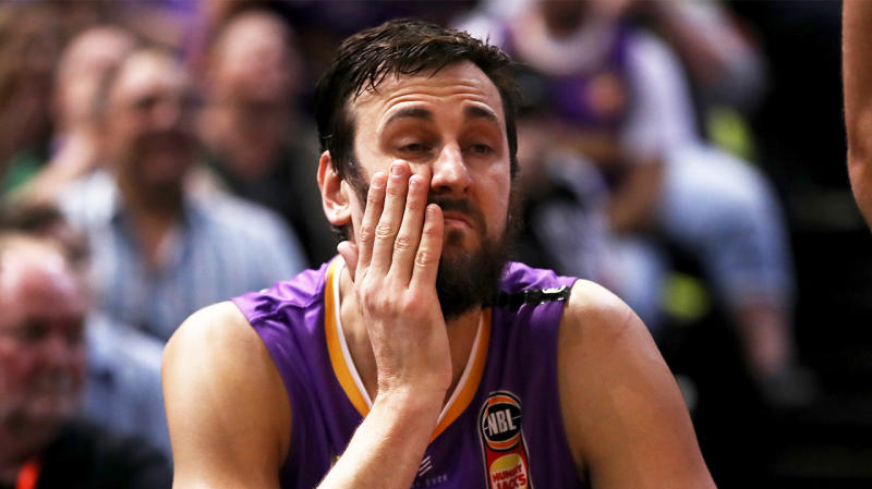 Andrew Bogut looks dejected on the bench during the NBL Grand Final series.