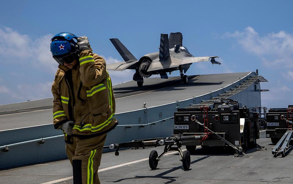 Ready for takeoff: crew on board the HMS Queen Elizabeth prepare F-35B fighter jets to take part in their first ever combat operation