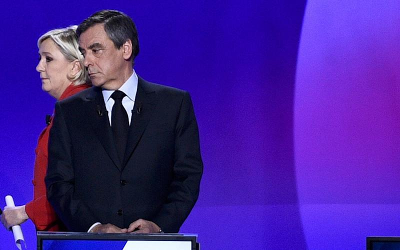 Francois Fillon and Marine Le Pen attend a special prime time political show on Thursday  - Credit: Reuters