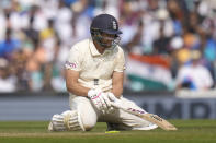 England's Dawid Malan reacts after he is run out on day five of the fourth Test match at The Oval cricket ground in London, Monday, Sept. 6, 2021. (AP Photo/Kirsty Wigglesworth)