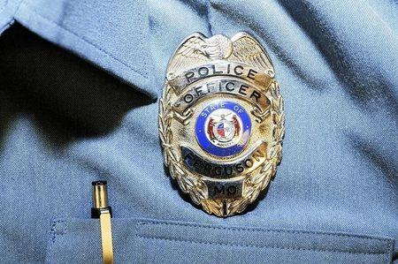 Officer Darren Wilson's police badge is pictured in this handout evidence photo from the August 9 Ferguson Police shooting of Michael Brown in Ferguson, released by the St. Louis County Prosecutor's Office on November 24, 2014.   REUTERS/St. Louis County Prosecutor's Office/Handout via Reuters