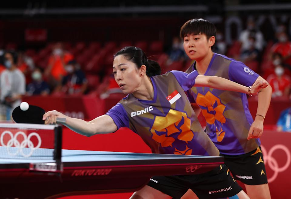 Singapore's Yu Mengyu (front) and Lin Ye in action against China's Chen Meng and Wang Manyu in the women's table tennis team competition at the 2020 Tokyo Olympics.