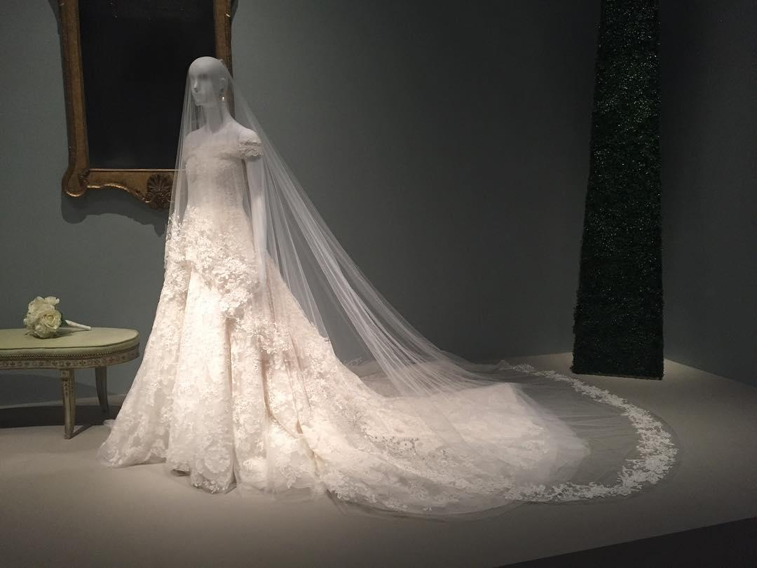 """<p><p>Titled <em>The Glamour and Romance of Oscar de la Renta</em>, the retrospective will open to the public Sunday and feature nearly 70 ensembles from the late designer's archives, including loans from top clients like Beyoncé herself. Style legend André Leon Talley appropriately curated the selection, and he described the team being """"very anxious"""" to receive Amal's bridal addition. """"We wanted it [in San Francisco last year], but Mrs. Clooney reached me through her assistant to say she felt it was too early to have her dress in an exhibit after she married [George],"""" he told <a rel=""""nofollow"""" href=""""http://wwd.com/eye/people/oscar-de-la-renta-exhibition-opening-museum-of-fine-arts-houston-11021167/""""><em>WWD</em></a>. Now if only we could book a quick flight to H-Town.</p>                                                                                                                                                                               <h4>@amuseabroad</h4>"""