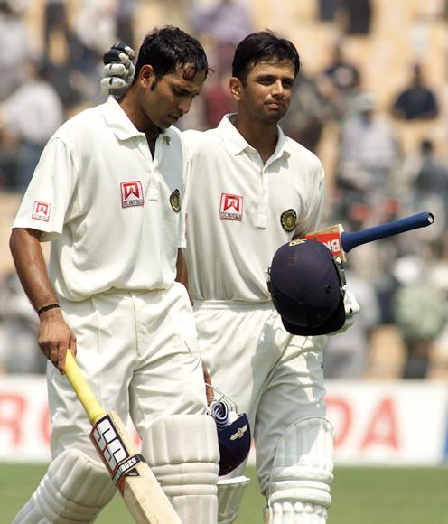 VVS Laxman (left) and Rahul Dravid of India leave the field at lunch, during day four of the 2nd Test between India and Australia played at Eden Gardens, Calcutta, India. X DIGITAL IMAGE  Mandatory Credit: Hamish Blair/ALLSPORT