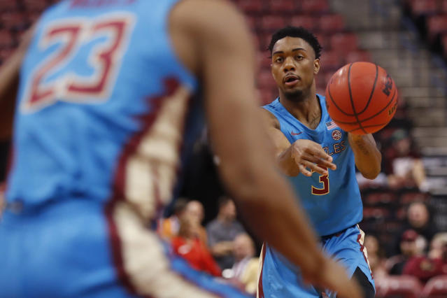 Florida State guard Trent Forrest (3) passes to guard M.J. Walker (23) in the first half of an NCAA college basketball game against South Florida, part of the Orange Bowl Classic tournament, Saturday, Dec. 21, 2019, in Sunrise, Fla. (AP Photo/Wilfredo Lee)
