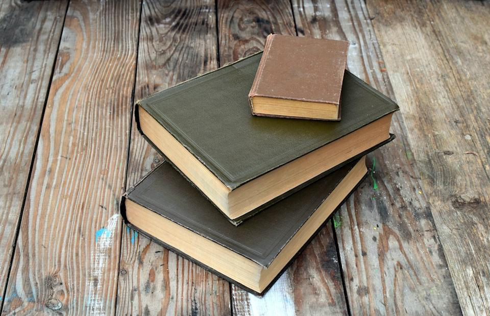old dusty books on wood table