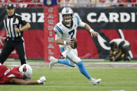 FILE - In this Sept. 22, 2019, file photo, Carolina Panthers quarterback Kyle Allen (7) scrambles during an NFL football game against the Arizona Cardinals, in Glendale, Ariz. Surviving in the NFL as a young quarterback means being able to move. That doesn't mean running as well as Lamar Jackson. Gardner Minshew, Kyle Allen and even Daniel Jones are showing that being able to elude pressure is a must to keep throwing the ball. (AP Photo/Rick Scuteri, File)