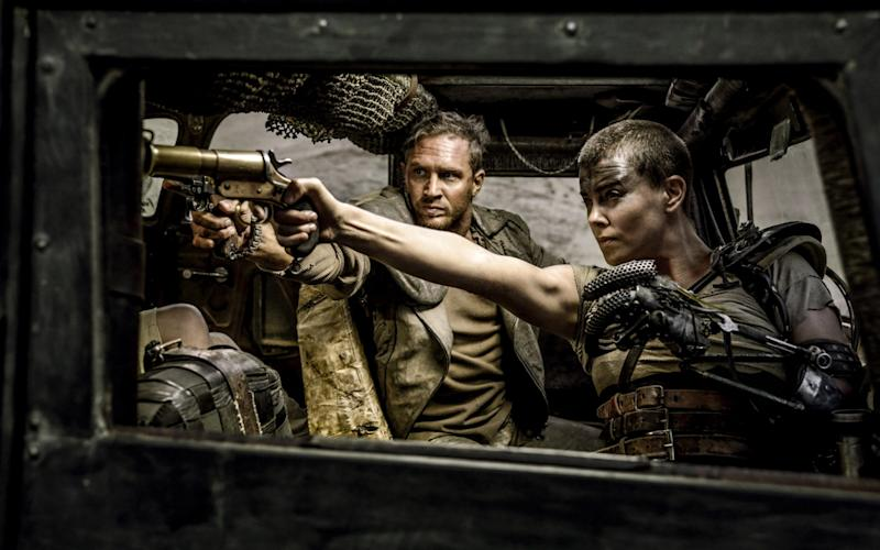 """This photo provided by Warner Bros. Pictures shows Tom Hardy, center, as Max Rockatansky and Charlize Theron, right, as Imperator Furiosa in Warner Bros. Pictures' and Village Roadshow Pictures' action adventure film, """"Mad Max:Fury Road"""" - Credit: Jasin Boland/Film Stills"""