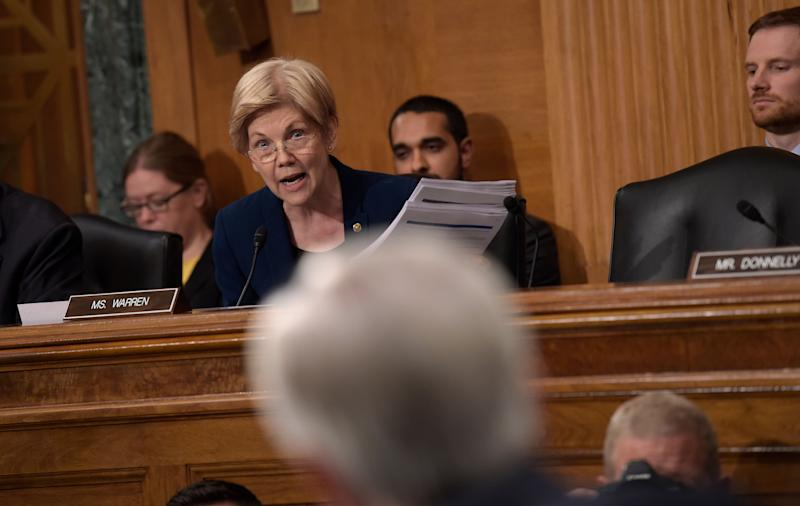In 2016, Senate Banking Committee member Elizabeth Warren (D-Mass.) questioned Wells Fargo CEO John Stumpf during a hearing on bank employees opening millions of unauthorized accounts to meet sales targets. (Photo: Susan Walsh/Associated Press)