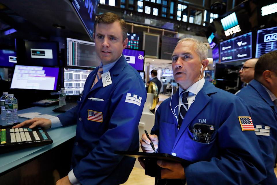 Specialist Thomas Schreck, left, and trader Timothy Nick work on the floor of the New York Stock Exchange, Tuesday, May 28, 2019. Stocks are rising at the open on Wall Street Tuesday, led by technology and consumer-focused companies. (AP Photo/Richard Drew)