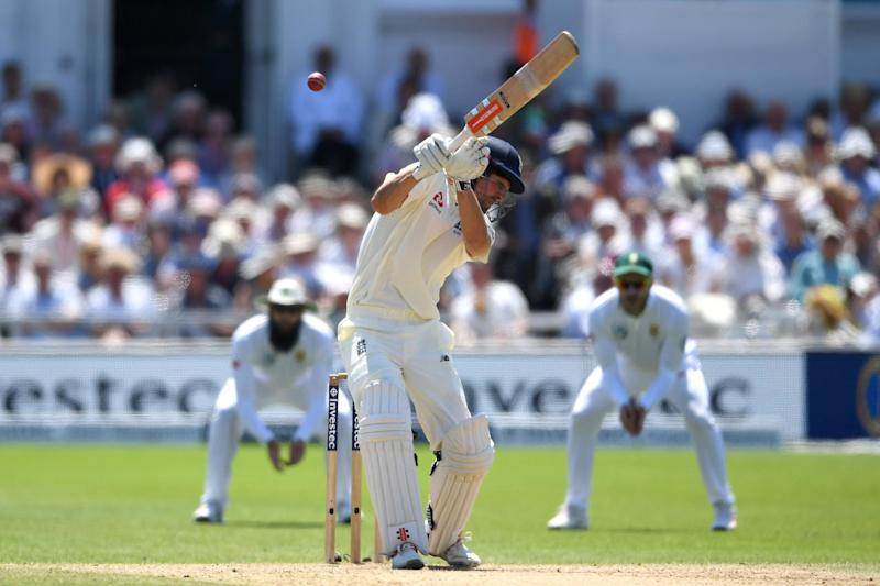 Take cover: Alastair Cook ducks away from a bouncer: Getty Images