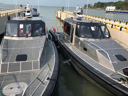 Patrol boats given by the United States to the Vietnamese Coast Guard are seen during a handover ceremony at a port in Phu Quoc Island