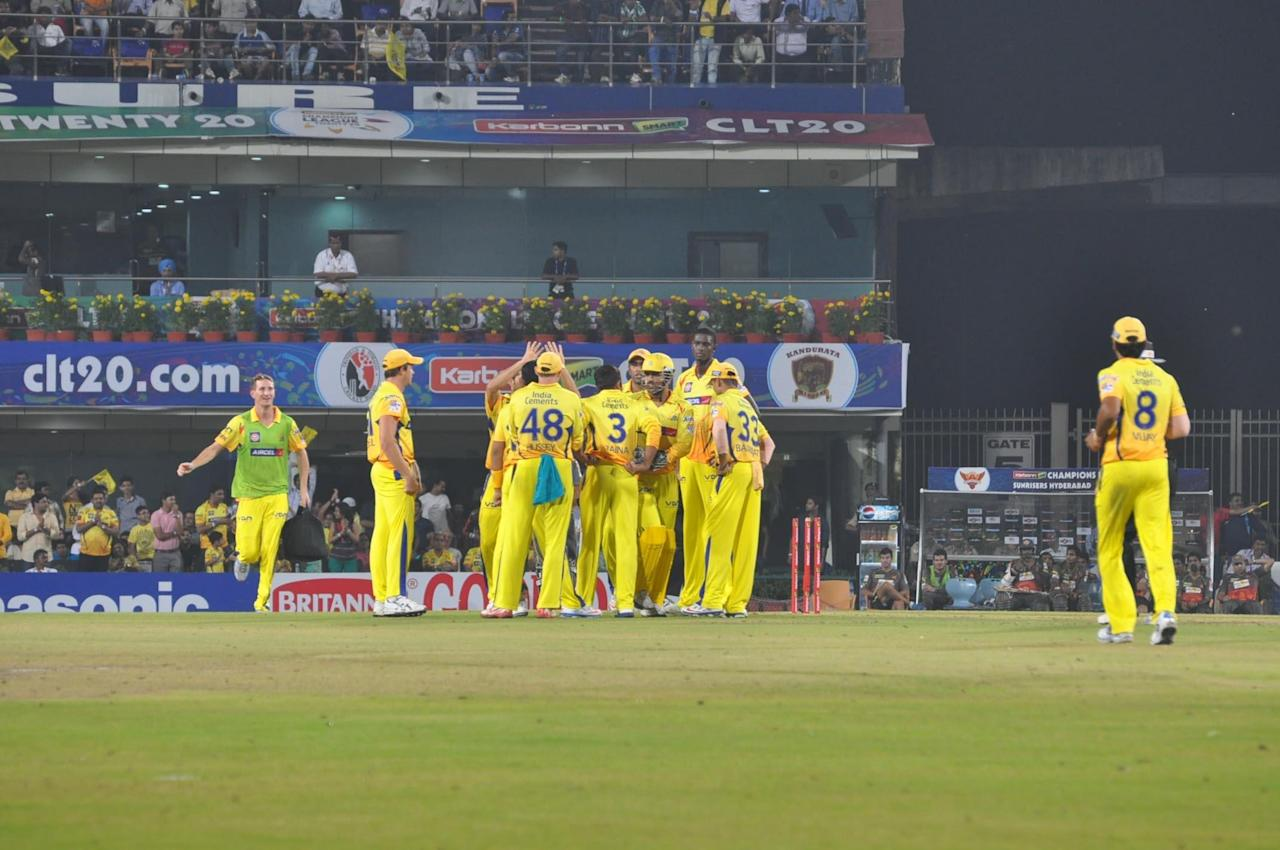 CSK players celebrate fall of wicket during the match against Sunrisers Hyderabad at Champions League Twenty-20 Match at Jharkhand State Cricket Association (JSCA) International Cricket Stadium in Ranchi on Sept. 26, 2013. (Photo: IANS)