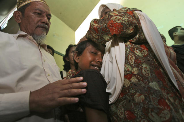 In this June 4, 2013 photo, young ethnic Rohingya asylum seeker Senwara Begum, center, cries during the trial of her brother, Mohamad Husein, who was accused of taking part in a brawl that left eight Buddhist Burmese fishermen dead, at a district court in Medan, North Sumatra, Indonesia. Senwara had slept through the brawl in a separate quarter for women. But when she awoke the next morning, her brother was gone. (AP Photo/Binsar Bakkara)