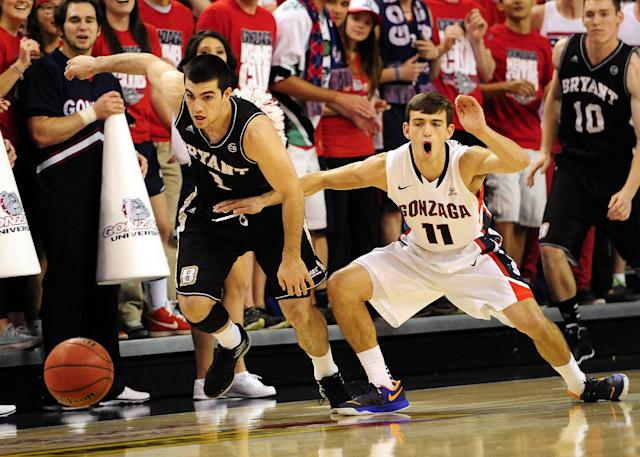 Gonzaga's David Stockton (11) knocks the ball away from Bryant's Corey Maynard in the first half of an NCAA college basketball game on Saturday, Nov. 9, 2013, in Spokane, Wash. (AP Photo/Jed Conklin)