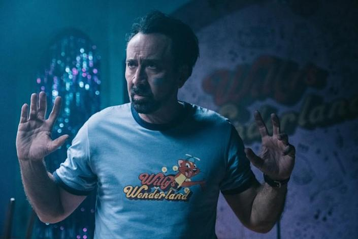"Nicolas Cage in the movie ""Willy's Wonderland."""