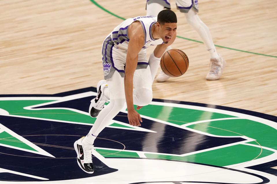 Sacramento Kings guard Tyrese Haliburton (0) loses control of the dribble and falls to the ground after suffering an unknown lower leg injury in the second half of an NBA basketball game against the Dallas Mavericks in Dallas, Sunday, May 2, 2021. (AP Photo/Tony Gutierrez)