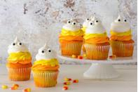 """<p>Mimic the layers of candy corn you love so much with these adorable cupcakes.</p><p>Get the recipe from <a href=""""https://www.delish.com/cooking/recipe-ideas/recipes/a43940/candy-corn-ghost-cupcakes-recipe/"""" rel=""""nofollow noopener"""" target=""""_blank"""" data-ylk=""""slk:Delish"""" class=""""link rapid-noclick-resp"""">Delish</a>.</p>"""