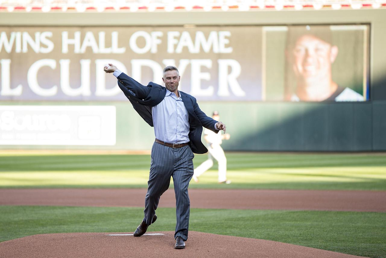 Aug 19, 2017; Minneapolis, MN, USA; Former Minnesota Twin Michael Cuddyer throws out a ceremonial first pitch after being inducted in the the Minnesota Twins hall of fame at Target Field. Mandatory Credit: Jesse Johnson-USA TODAY Sports   TPX IMAGES OF THE DAY