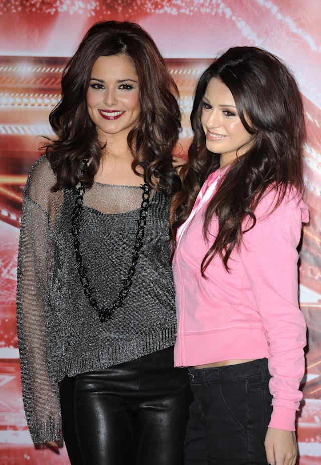 Cheryl Cole and Cher Lloyd ahead of the live X Factor final in 2010 (PA)