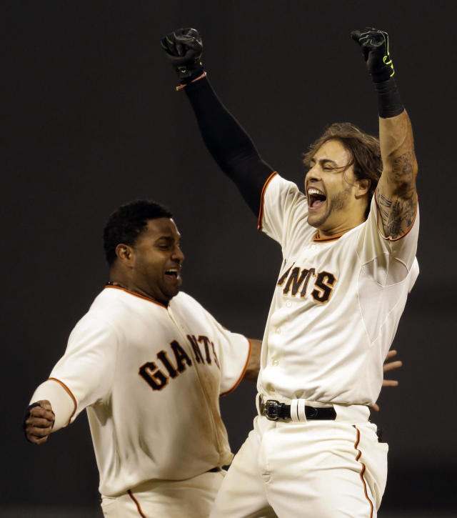 San Francisco Giants' Michael Morse, right, and Pablo Sandoval celebrate after Morse made the game winning hit in the ninth inning of a baseball game against the New York Mets Saturday, June 7, 2014, in San Francisco. (AP Photo/Ben Margot)