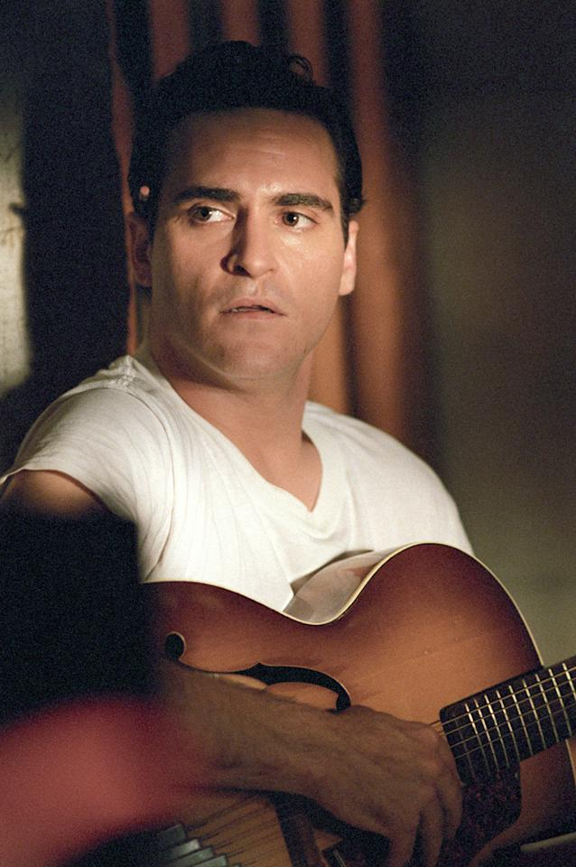 "Joaquin Phoenix had some big cowboy boots to fill when he agreed to portray music legend Johnny Cash in the 2005 drama ""Walk the Line."" The actor said that the first thing he did after nabbing the role was to buy a guitar and learn how to play. He also did his own singing in the film. His efforts paid off because he received some of the best reviews of his career as well as an Oscar nomination. Reese Witherspoon, who won an Academy Award for her portrayal of June Carter Cash, said Joaquin's top-notch performance inspired her own. ""The moment that he had to step on stage and be in the clothes and <em>be</em> Johnny Cash, he just had this incredible confidence,"" she later said. ""And he didn't break. He wasn't nervous or insecure. Maybe he was on the inside, but from what I saw, he really inspired me.""<br><br><a target=""_blank"" href=""http://www.amazon.com/Walk-Widescreen-Edition-Joaquin-Phoenix/dp/B000E8QVWY"">Buy ""Walk the Line"" on DVD</a>"