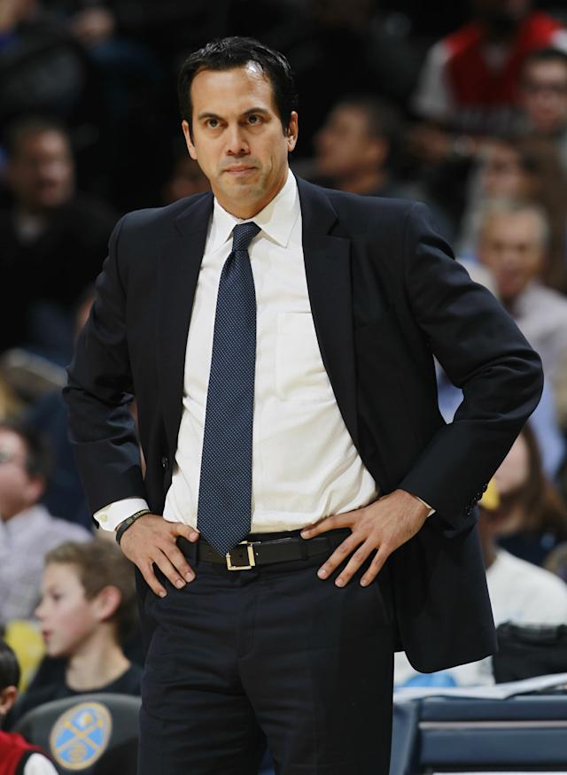 Miami Heat head coach Erik Spoelstra reacts to call against his team while facing the Denver Nuggets in the first quarter of an NBA basketball game in Denver on Monday, Dec. 30, 2013. (AP Photo/David Zalubowski)