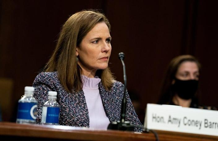 A vote to confirm Supreme Court nominee Judge Amy Coney Barrett, shown testifying before the Senate Judiciary Committee on the third day of her confirmation hearing, is slated to take place on Monday. (Photo by Anna Moneymaker-Pool/Getty Images)