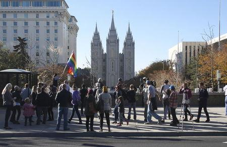 Members of The Church of Jesus Christ of Latter-day Saints and their supporters walk near the Salt Lake Temple after mailing their membership resignation to the church in Salt Lake City, Utah November 14, 2015. REUTERS/Jim Urquhart