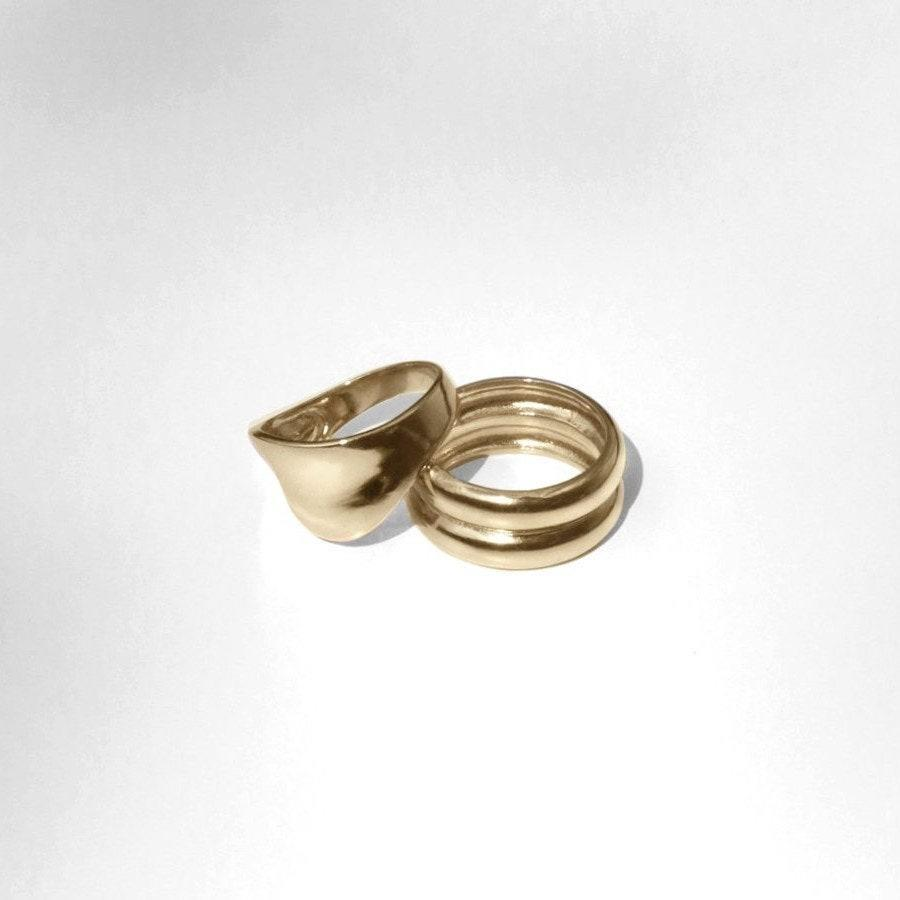"<p>Nothing says ""effortlessly cool"" more than a mismatched pair of gold rings. Young Frankk's Ring Duo is made from recycled gold brass. It's a stylish and eco-friendly gift for a mix of stylish folks on your list. They can wear the double-domed and wider dimpled rings separately or stacked together. </p> <p><strong>$146</strong> (<a href=""https://www.youngfrankk.com/collections/rings/products/crest-ring-and-varro-ring-set"" rel=""nofollow noopener"" target=""_blank"" data-ylk=""slk:Shop Now"" class=""link rapid-noclick-resp"">Shop Now</a>)</p>"