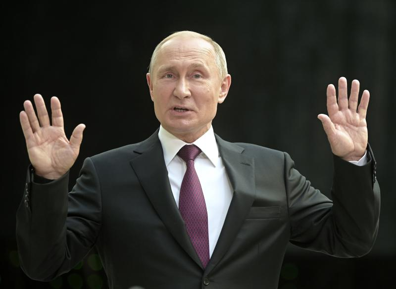 Russian President Vladimir Putin gestures answers a question after his annual call-in show in Moscow, Russia, Thursday, June 20, 2019. Putin hosts call-in shows every year, which typically provide a platform for ordinary Russians to appeal to the president on issues ranging from foreign policy to housing and utilities. (AP Photo/Alexander Zemlianichenko)