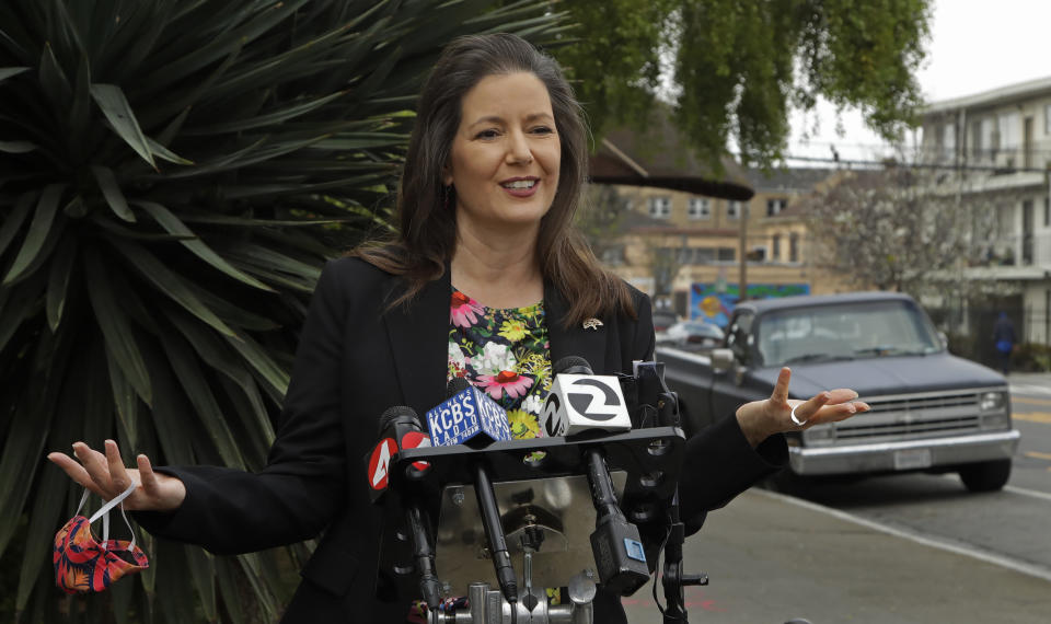 Oakland Mayor Libby Schaaf gestures while speaking at a media conference on Friday, April 10, 2020, in Oakland, Calif. Schaaf announced an initiative designed to make it safer to exercise and move about in Oakland by designating 74 miles of neighborhood streets for through traffic by bikes, pedestrians, wheelchair users, and local vehicles only, starting Saturday, April 11. (AP Photo/Ben Margot)