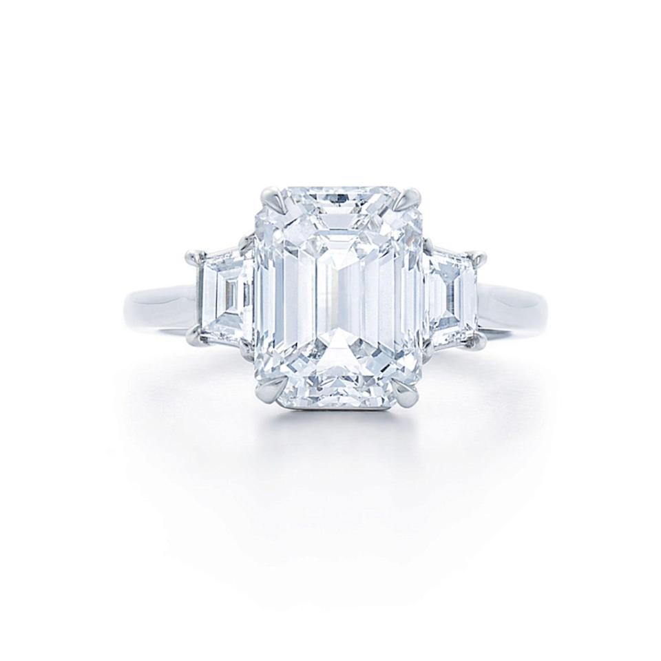 "$4600, Kwiat. <a href=""https://kwiat.com/diamond-jewelry/emerald-cut-diamond-engagement-ring-with-two-step-cut-trapezoid-side-stones-in-platinum-style-f-17614e-0-dia-plat/"" rel=""nofollow noopener"" target=""_blank"" data-ylk=""slk:Get it now!"" class=""link rapid-noclick-resp"">Get it now!</a>"