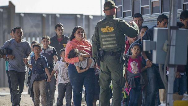 PHOTO: Migrants are loaded onto a bus by U.S. Border Patrol agents after being detained when they crossed into the United States from Mexico on June 01, 2019 in El Paso, Texas. (Joe Raedle/Getty Images)