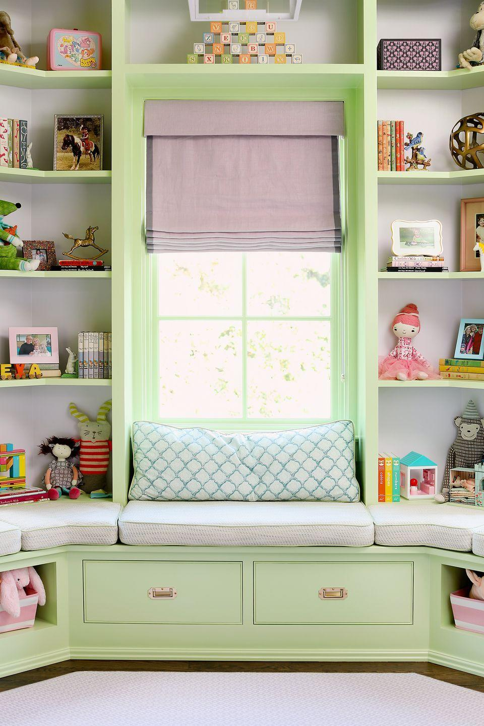 """<p>MA Allen Interiors' client wanted a room that would empower her two-year-old grandchild """"to grow and pursue anything under the sun,"""" so the North Carolina designer built in magical surprises to promote discovery and wonder. Basically it's a dream play space. To keep toys out the way, open shelves with baskets come in handy. For a similar effect, create smart seating and storage in your kids' playroom by turning two bookcases on their sides and adding cushions on top.</p>"""