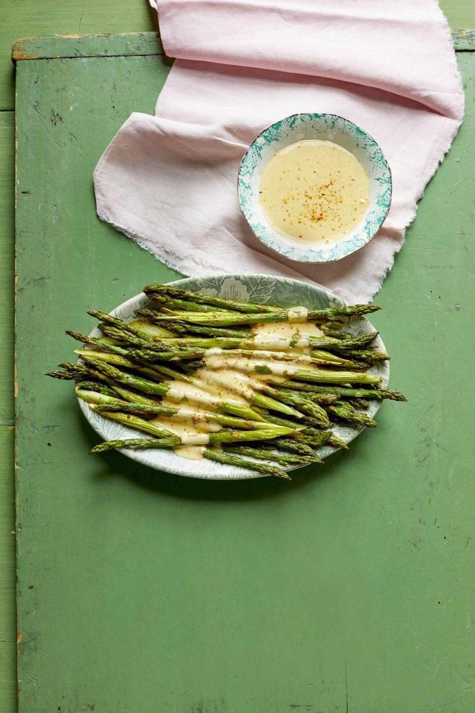 """<p>Did you know hollandaise is good on more than just eggs Benedict? It's amazing on roasted veggies like asparagus—especially when it has a hint of Cajun seasoning in it.</p><p><strong><a href=""""https://www.thepioneerwoman.com/food-cooking/recipes/a35584543/roasted-asparagus-with-cajun-hollandaise-recipe/"""" rel=""""nofollow noopener"""" target=""""_blank"""" data-ylk=""""slk:Get the recipe."""" class=""""link rapid-noclick-resp"""">Get the recipe.</a></strong></p><p><a class=""""link rapid-noclick-resp"""" href=""""https://go.redirectingat.com?id=74968X1596630&url=https%3A%2F%2Fwww.walmart.com%2Fsearch%2F%3Fquery%3Dpioneer%2Bwoman%2Bserving%2Bplates&sref=https%3A%2F%2Fwww.thepioneerwoman.com%2Ffood-cooking%2Fmeals-menus%2Fg35514088%2Fbest-side-dishes-for-ham%2F"""" rel=""""nofollow noopener"""" target=""""_blank"""" data-ylk=""""slk:SHOP SERVING PLATES"""">SHOP SERVING PLATES</a></p>"""