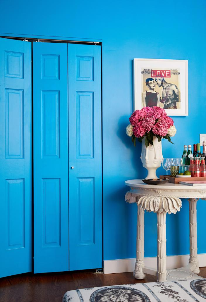 Courtney originally hails from New Orleans, and the vibrant city lends inspiration throughout her home's bold hues.