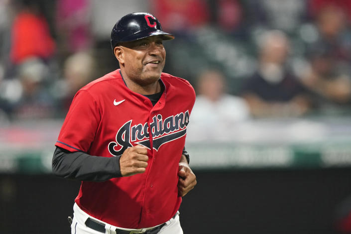 """Cleveland Indians first base coach Sandy Alomar Jr. runs out on the field during a baseball game against the Kansas City Royals, Tuesday, Sept. 21, 2021, in Cleveland. On Sunday, one of the American League's charter members will play its final home game of 2021, and also its last at Progressive Field as the Indians, the team's name since 1915, when """"Shoeless"""" Joe Jackson was the starting right fielder on opening day. Much more than a late-season matchup against the Chicago White Sox, the home finale will signify the end of one era and beginning of a new chapter for the team, which will be called the Cleveland Guardians next season. (AP Photo/Tony Dejak)"""