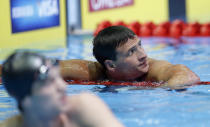 Ryan Lochte looks at time time after swimming in the men's 400-meter individual medley preliminaries at the U.S. Olympic swimming trials, Monday, June 25, 2012, in Omaha, Neb. (AP Photo/David Phillip)