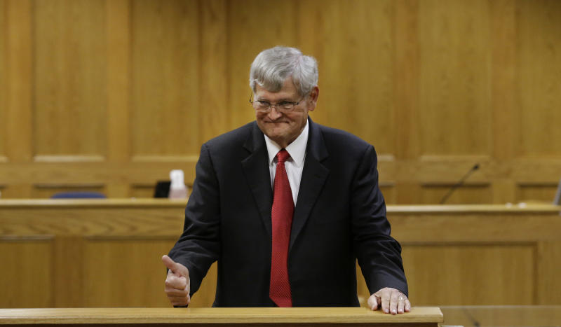 Panola County District Attorney Danny Buck Davidson gives a thumbs up before a court hearing for Bernie Tiede in Carthage, Texas, Tuesday, May 6, 2014. Tiede, a former mortician whose killing of a rich widow shook an East Texas town and later inspired a movie will soon go free, after the district attorney who prosecuted him agreed to let him out of a life sentence. (AP Photo/LM Otero)