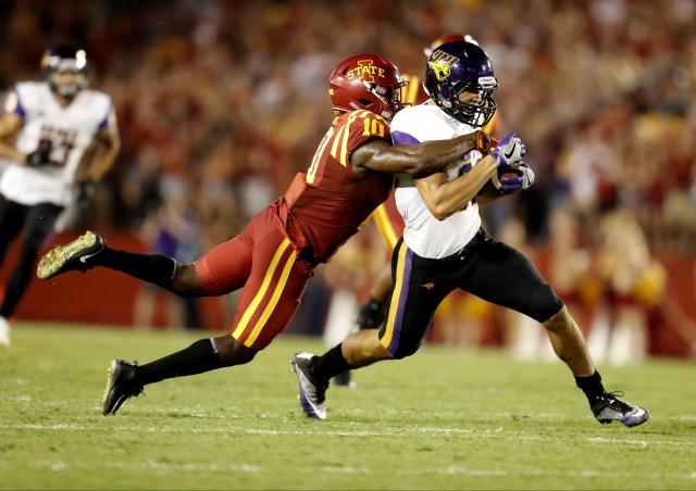 """AMES, IA – SEPTEMBER 2: Wide receiver <a class=""""link rapid-noclick-resp"""" href=""""/ncaaf/players/266657/"""" data-ylk=""""slk:Isaiah Weston"""">Isaiah Weston</a> #80 of the Northern Iowa Panthers is tackled by defensive back Brian Peavy #10 of the <a class=""""link rapid-noclick-resp"""" href=""""/ncaab/teams/iao/"""" data-ylk=""""slk:Iowa State Cyclones"""">Iowa State Cyclones</a> as he rushed for yards in the first half of play at Jack Trice Stadium on September 2, 2017 in Ames, Iowa. (Photo by David Purdy/Getty Images)"""