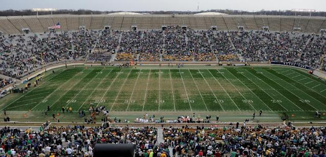 The field at Notre Dame Stadium during half time in Notre Dame's spring NCAA collegefootball game Saturday April 12, 2014 in South Bend, Ind. The Blue Gold game marks the end of spring football practice. Artificial turf will be installed at the stadium in time for the start of the upcoming football season, athletic director Jack Swarbrick said. (AP Photo/Joe Raymond)